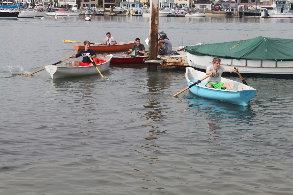 Club members round a corner during a recent rowing race.