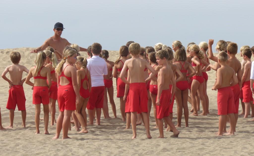 Junior Lifeguards listen to an instructor.