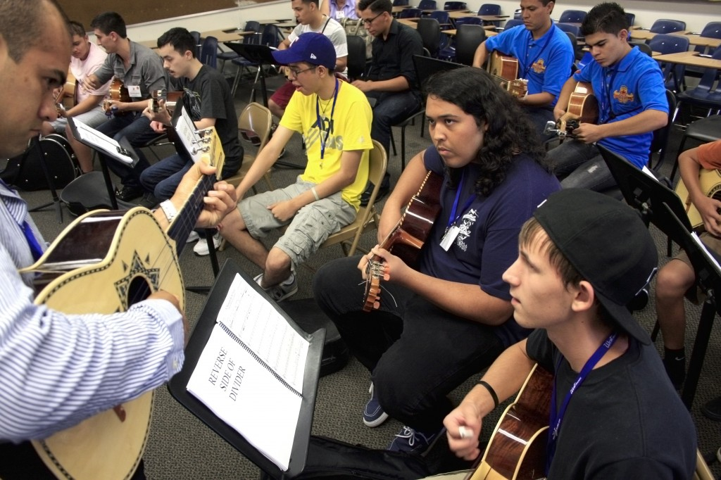 Alex Fierro, 16, (right) and Alejandro Yanez, 18, (front, middle) practice a song on their vihuelas and listen to instructor Anthony Zuniga in the Advanced Armonia class on Wednesday during the first day of the Mariachi Nationals and Summer Institute. — Photos by Sara Hall