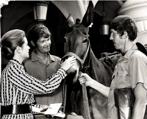 Princess Grace Kelly of Monaco petting Willie Makeit II with Dave and John Kunst.