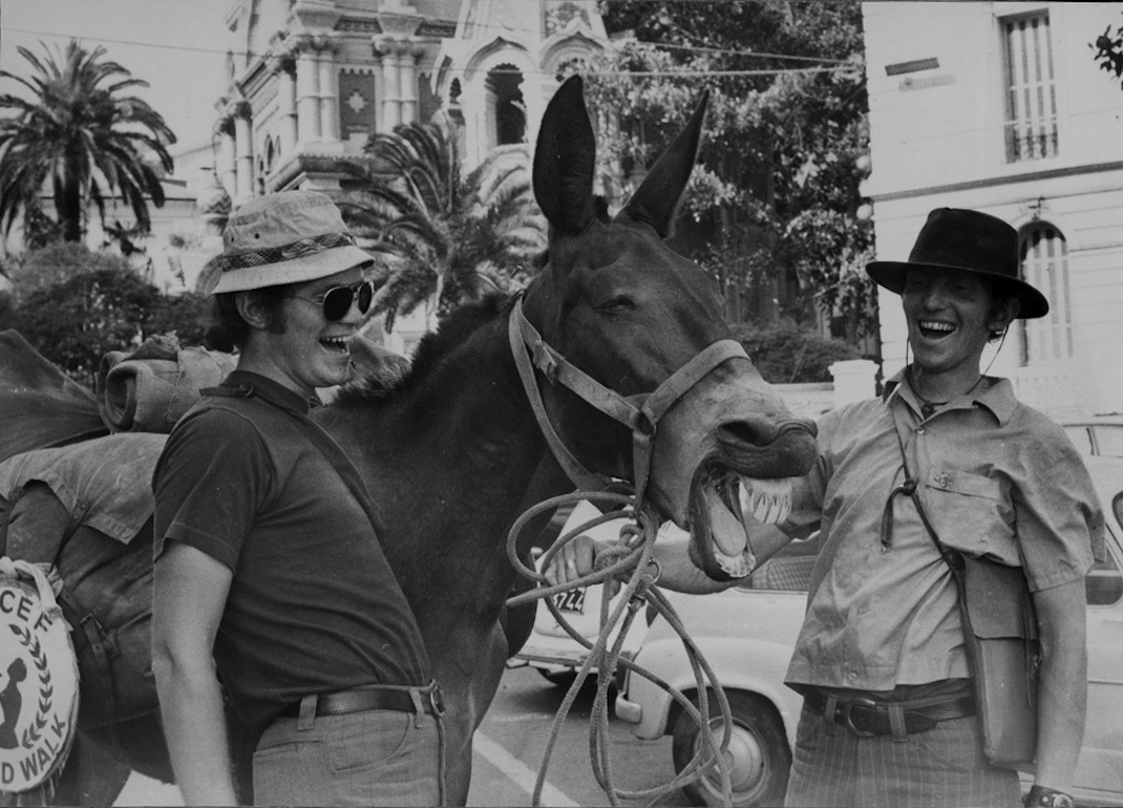 The Kunst brothers Dave and John and one of their mules share a joke in San Remo, Italy.