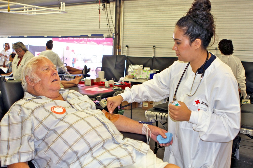 Red Cross worker Moana Vaouli  draws blood from Bob Silverman at Wednesday's lifeguard blood drive. — Photos by Jim Collins