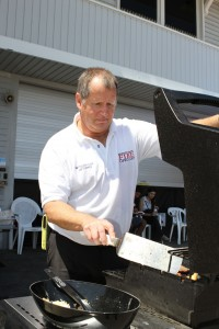 Lifeguard Battalion Chief and drive organizer, Jim Turner, cooks up burgers for the day's donors.