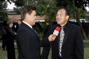 Scott Stewart host of What's Up OC speaks to Santa Ana Zoo Director Kent Yamaguchi
