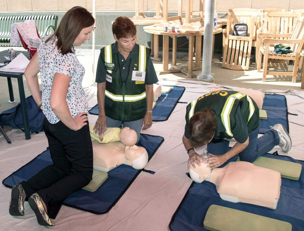 CERT volunteers demonstrate CPR on mannequins for visitors to the expo.  — Photo by Charles Weinberg