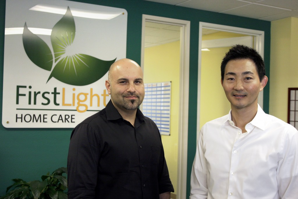 FirstLight HomeCare owners Ray Kikavousi (left) and Charles Park at their Orange County office.