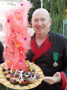 White house owner Bruno Serato with one of his signature desserts