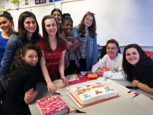 Spare Change for Change club members celebrate a meeting with Kristi Piatkowski with cake for everyone.