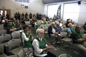 In the friends room at the Newport Beach Library on Tuesday, CERT volunteers, NBFD personnel and community members cheer after Matt Brisbois spoke during the Champions of Change ceremony, which streamed live from the White House.