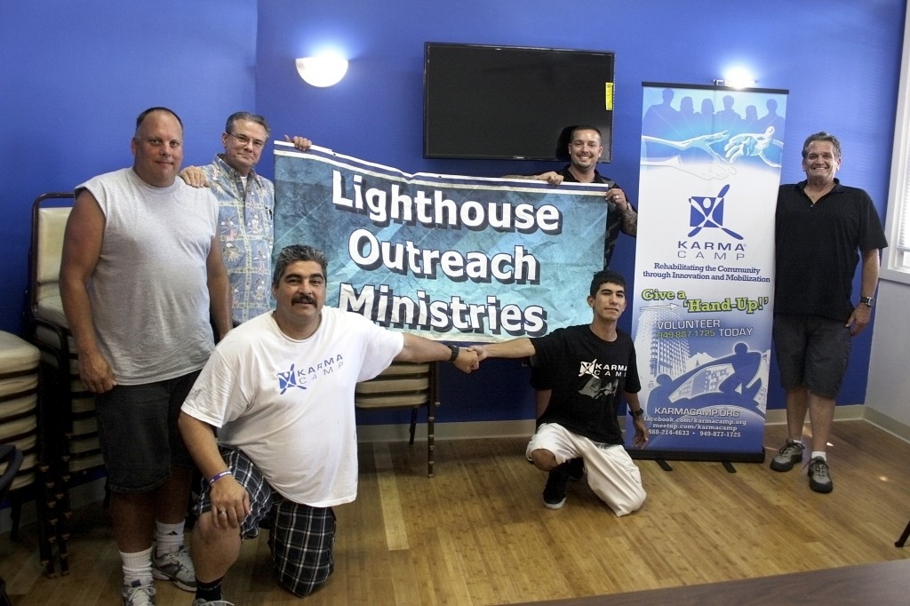 (left to right) Lighthouse Resident Manager John Melin, Lighthouse Pastor Phil Eyskens, Karma Camp sponsored sober living residents Rudy Gonzales Jr. and Steven Andrew Novelo (both kneeling), Karma Camp Executive Director Greg Sipe, and John Tomkinson from Karma Camp.