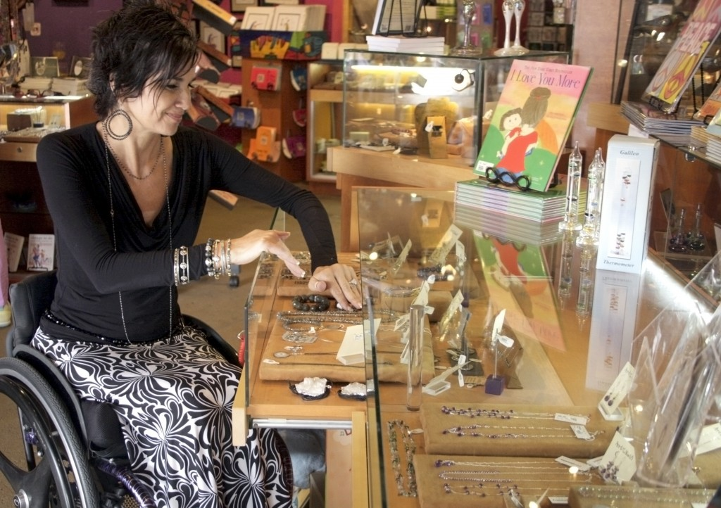 Martin rearranges some jewelry at her store on Balboa Island.