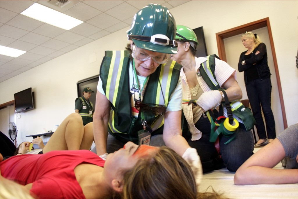 "CERT volunteers assess ""victims,"" played by members of the National Charity League, in the triage station."