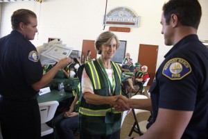 A new CERT graduate receives her diploma on Saturday.