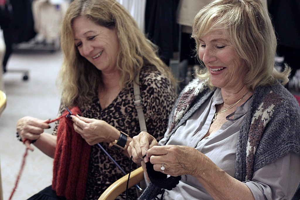 Orelia Steinhardt of Irvine and Carol Shehab of Newport Beach knit while they chat during the event.