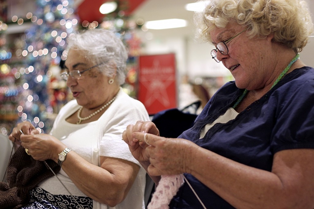 Astrid Sciolini of Costa Mesa (left) and Judy Treble of Tustin knit and crochet items in Macy's at Fashion Island on Saturday for Spa Gregorie's sixth annual Knit One, Cure Too knit-a-thon event for the Orange County affiliate of Susan G. Komen for the Cure. — All photos by Sara Hall