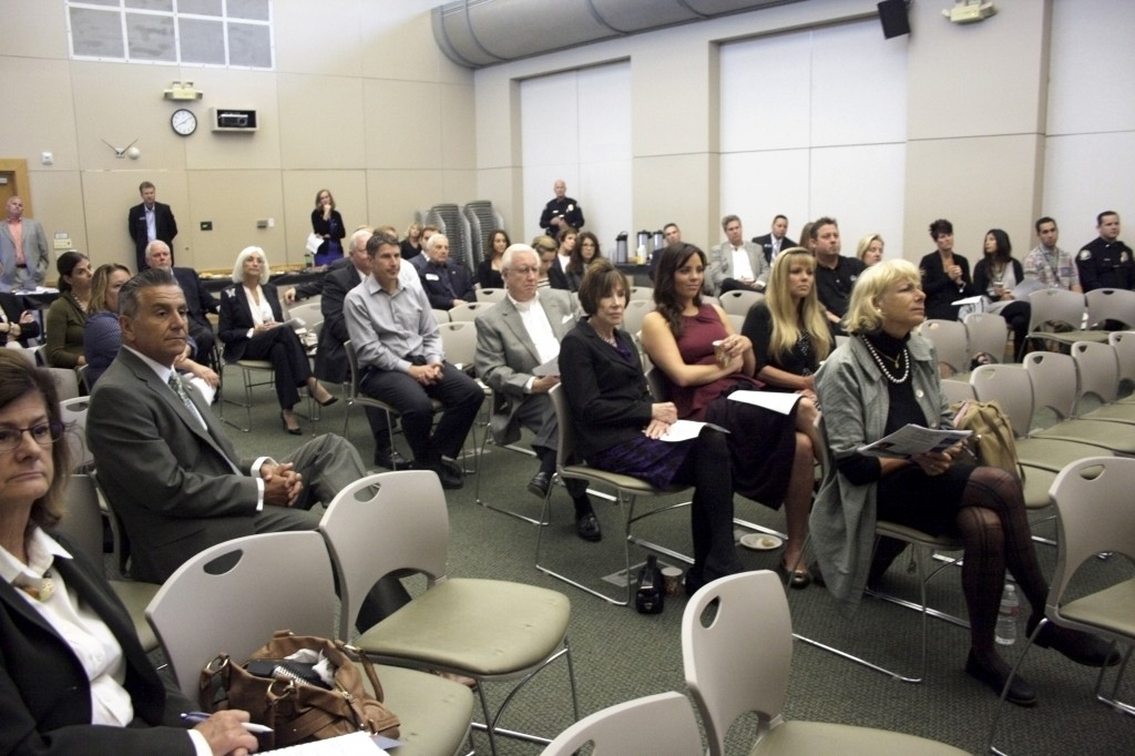 Audience members listen to Navarro speak about district goals and areas of focus.