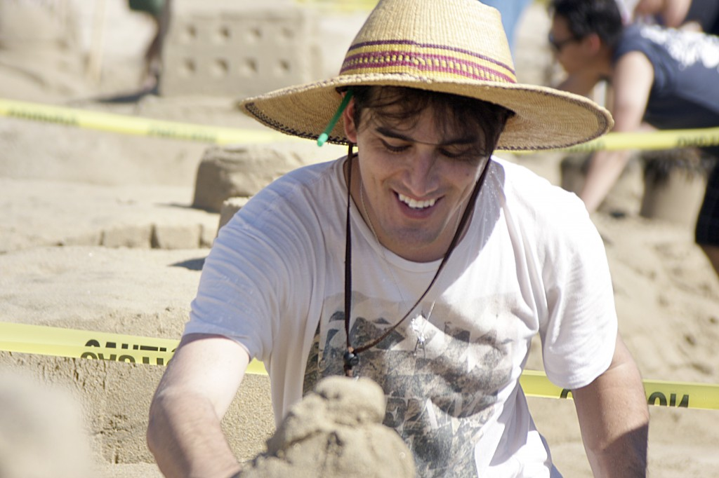 Rion Suarez of Los Angeles works on the McCool Family sand sculpture on Sunday.