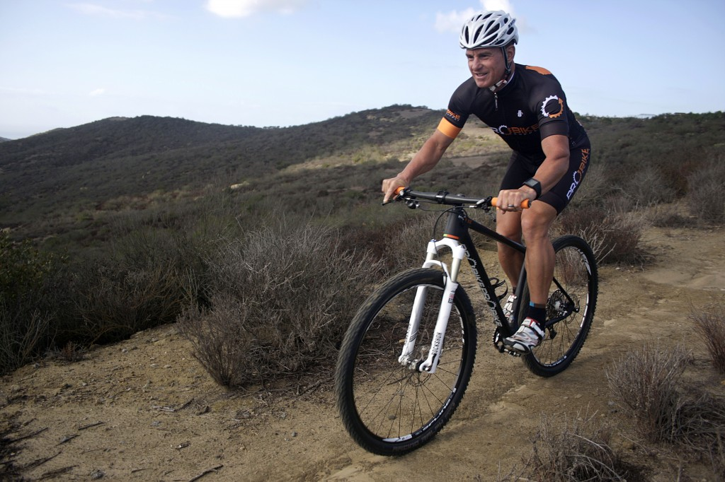 George Vitolo training on the donated bicycle on a trail in Newport Beach.