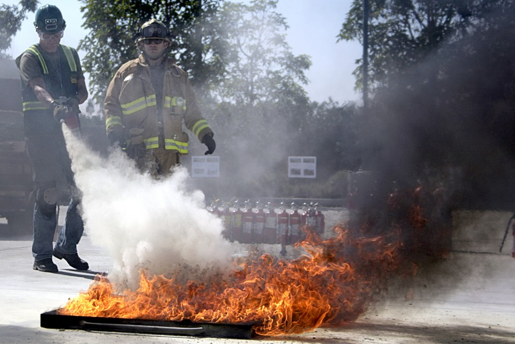 A Community Emergency Response Team members extinguishes a blaze during the program's Drill the Skills event on Saturday. — All photos by Sara Hall