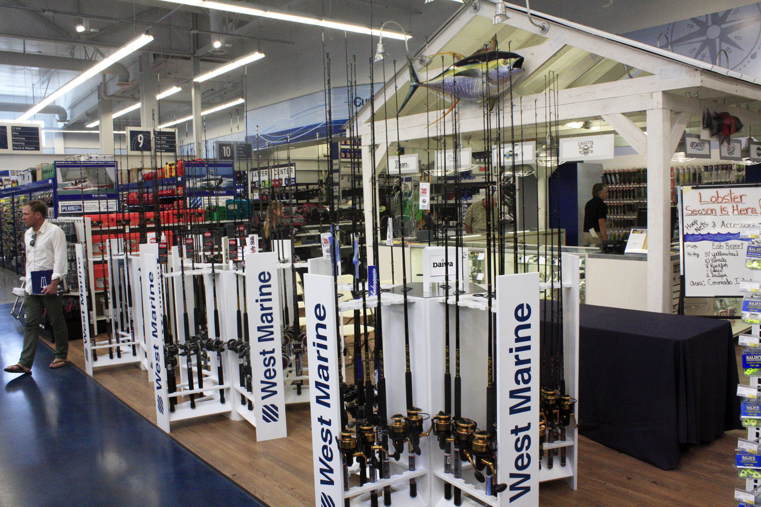 Newport beach local news biz buzz west marine flagship for Best way to store an outboard motor