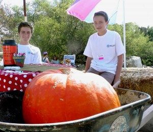 Members of the National League of Young Men Newport Mesa chapter volunteer at the ENC Fall Faire. — Photo by Lori Whalen