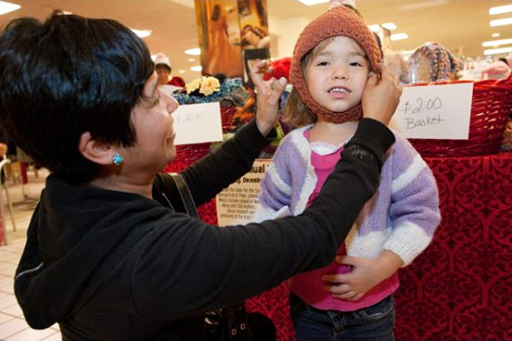 A shopper purchases a cap at the 2011 Knit-a-Thon event. — Photo by Kathy Leek