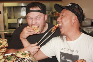 Chef Trevor Kotchek and Sgt. Pepperoni's co-owner Andy Hong clown around in the kitchen