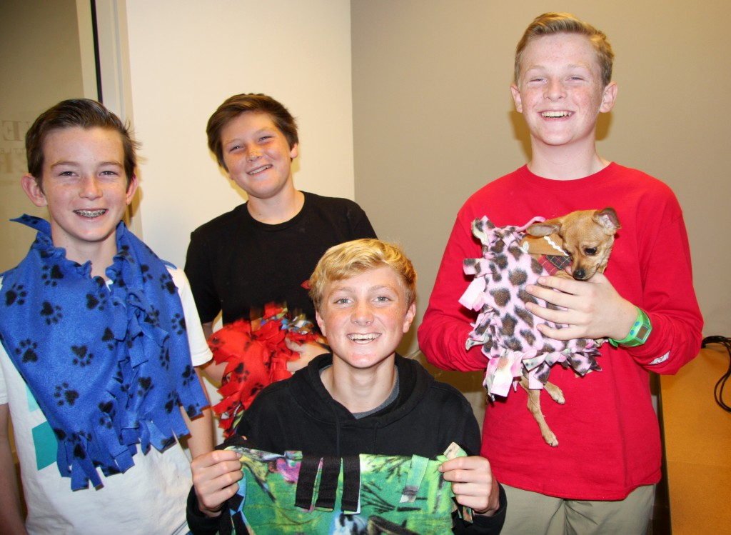 Campbell Norris, John Olmstead, Ethan Barnes and Sam Barela, all 13, holding Sunny, who was adopted at the event. — Photo by Allison Olmstead/Townsend Olmstead Media Company