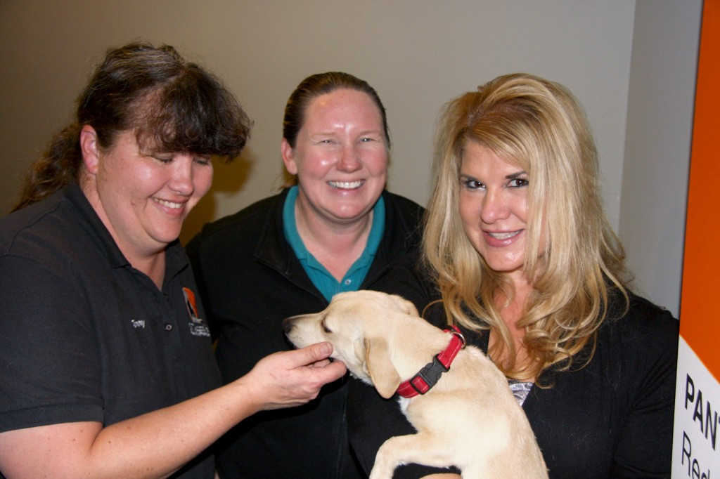 Tammy Osborn, Katie Ingram, Community Outreach Supervisor at OC Animal Care, and Karen Weinberg, with Barney. — Photo by Allison Olmstead/Townsend Olmstead Media Company