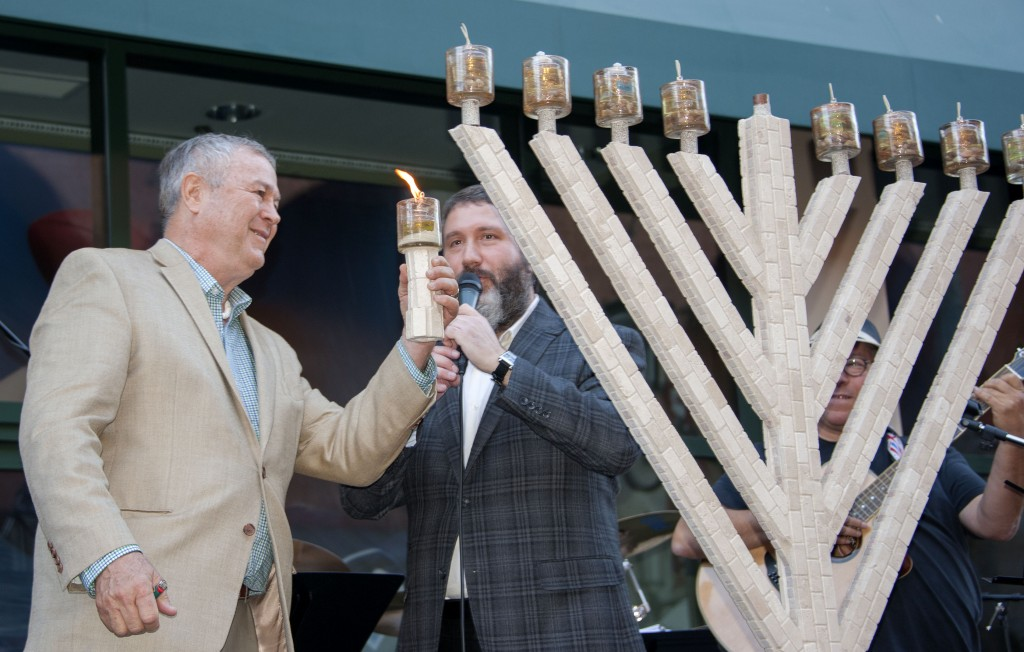 Congressman Dana Rohrabacher lit the Chanukah menorah at Fashion Island last weekend. — Photo by Charles Weinberg