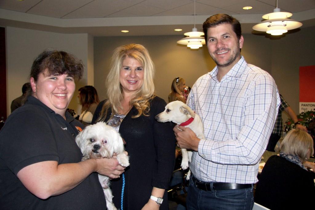 (left to right) Tammy Osborn, Adoption Partner Coordinator for OC Animal Care, with shelter pup Jack Frost, Karen Weinberg, HÔM CFO, and Bob Bonanno, HÔM President with Barney.