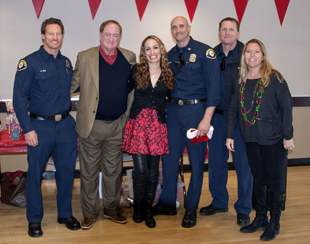 (left to right) Newport Beach Fire Department paramedic J.C. Nessa, councilman Keith Curry, MOMS carnival event chair Sherry Roshan Fredrick, fire investigator Capt. Mike Liberto, engineer Justin Kime, and MOMS member Heather Ignatin.