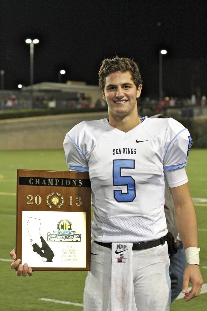 CdM quarterback Luke Napolitano with the team's winning plaque.