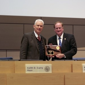 Dec.: Rush Hill takes over as mayor.