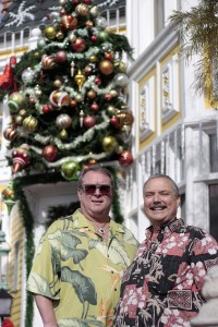 Mark Hurd (right) and Kevin Kramp outside their festive home. — Photo by Sara Hall