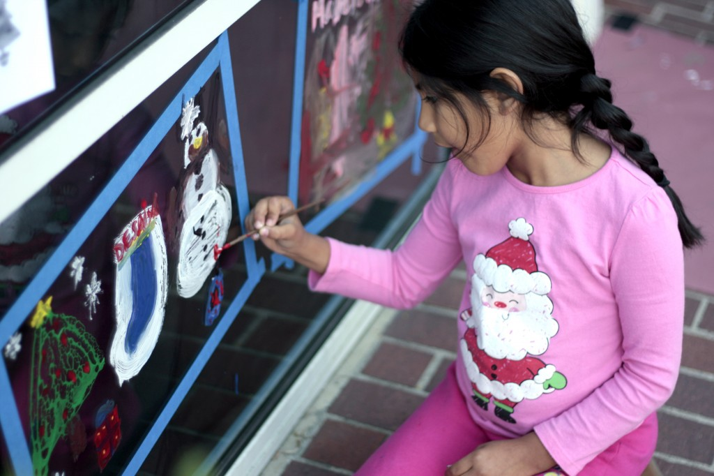 Desaiya Florian, 7, a second grader, works on her painted display at ExplorOcean on Wednesday.