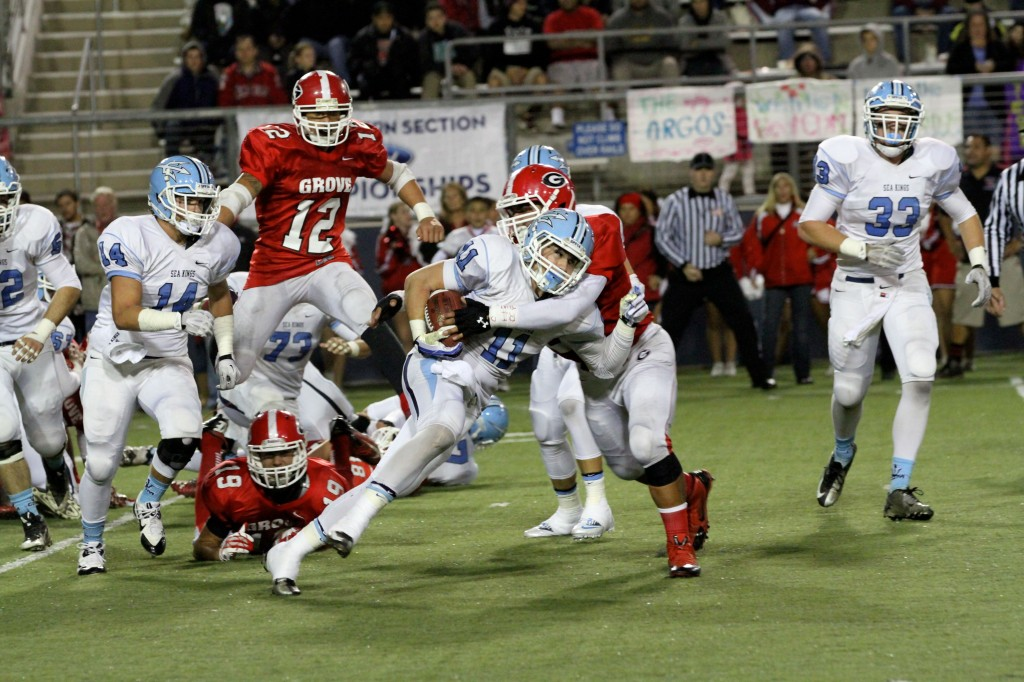 Corona del Mar High School running back Cole Martin pushes forward during the championship game against Garden Grove on Friday. CdM won 42-21. — All photos by Jim Collins