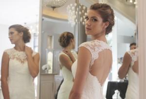 Kelli Reichel models a Casablanca Bridal gown. Photo by Christopher Trela.