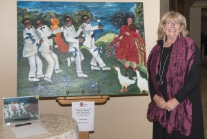 Newport Beach artist Ilona Martin with her artwork in the silent auction