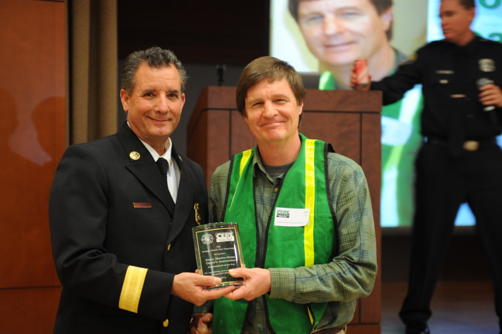 Fire Chief Scott Poster with Jim Gula, leader of Dover Shores Home Owner's Association, which won Neighborhood of the Year. — All photos by Charles Weinberg