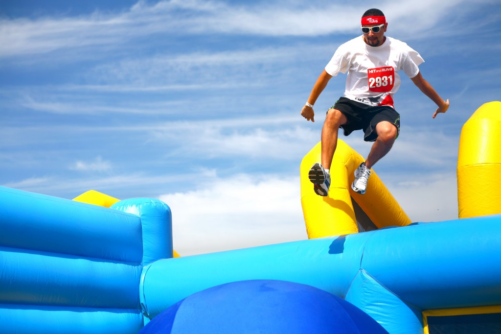 A participant jumps onto the first ball of the Bouncy Bridge obstacle. — All photos by Sara Hall