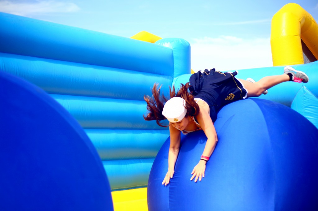 Jackie Dixon flops onto the first ball in the Bouncy Bridge obstacle.