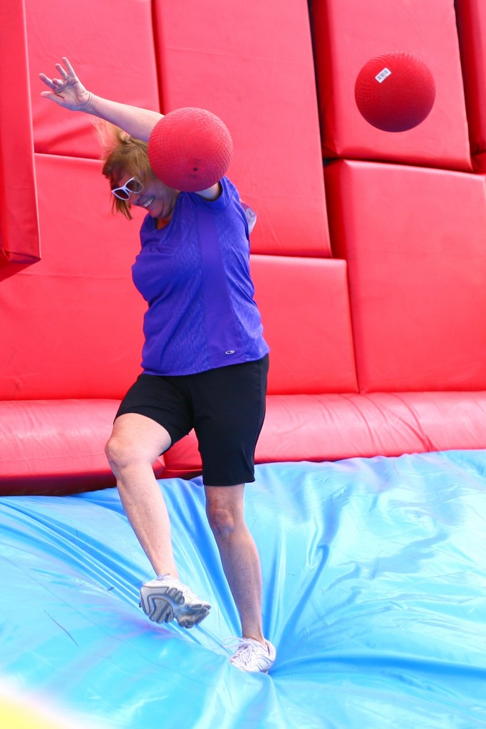 A woman gets knocked in the get with a red ball thrown by another Hit and Run participant at the Whacking Wall obstacle.