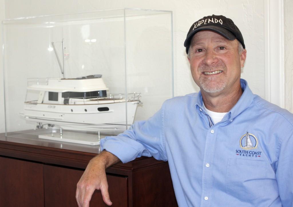 Jody Krimstock with a Beneteau boat model.  — Photo by Chris Trela