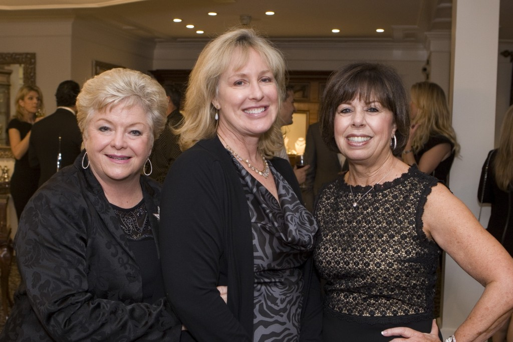 From the Newport-Mesa Assistance League, Johanna Roe, Kathy Youngman (president), and Joanne Johnston.