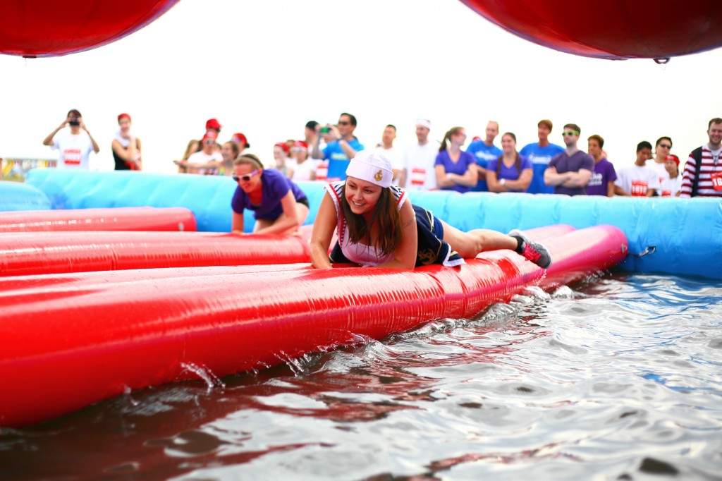 Jackie Dixon crawls across the Duck or Dive obstacle.