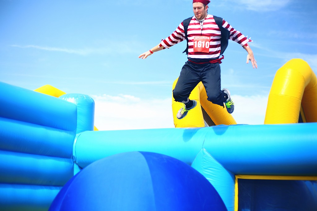 Ted Dixon jumps onto the first oversized bouncy ball in the Bouncy Bridge obstacle.