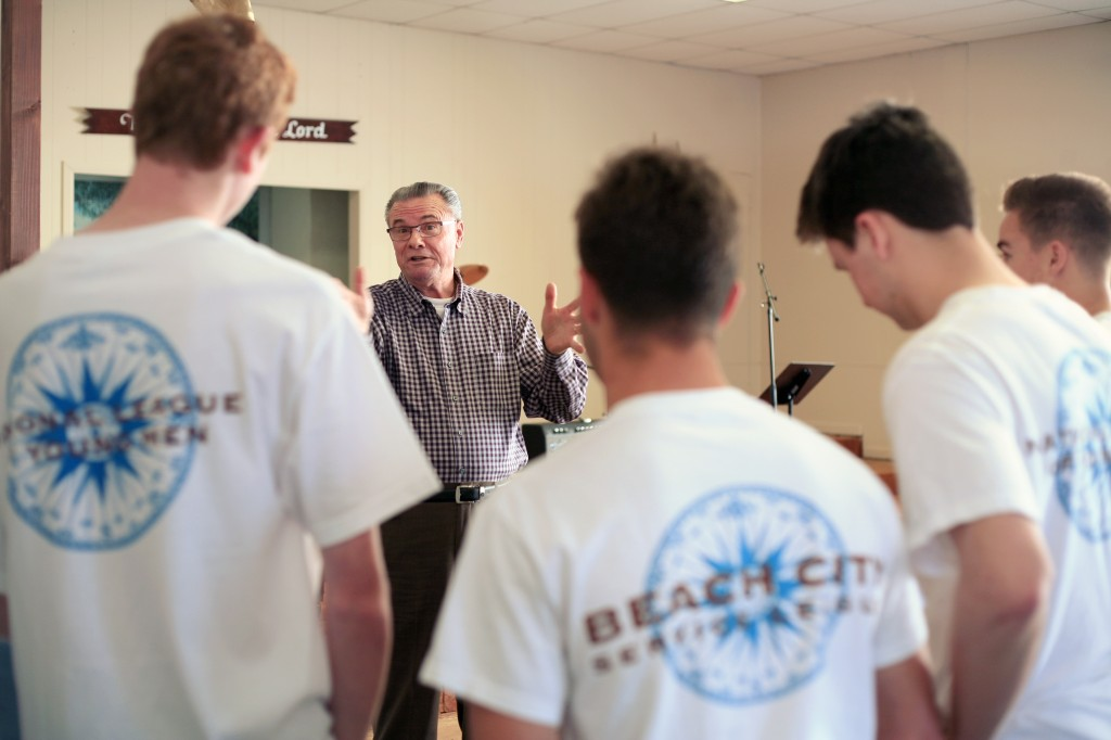 Lighthouse Pastor Phil Eyskens talks to the boys from the National League of Young Men, Newport Mesa chapter, after they helped renovate the building. — All photos by Sara Hall