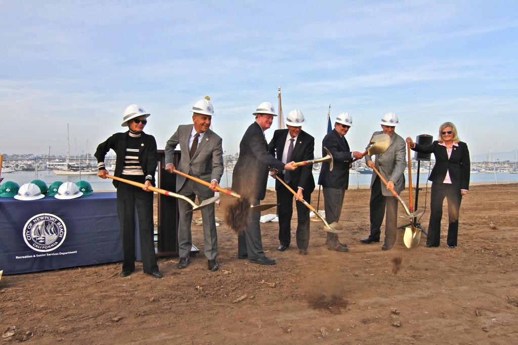 City council members break ground at the Marina Park site on Tuesday, from left to right: Council members Nancy Gardner, Tony Petros and Keith Curry, Mayor Rush Hill, Mayor Pro Tem Ed Selich, and council members Mike Henn and Leslie Daigle — NB Indy Staff