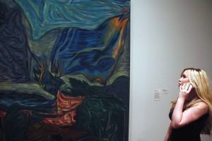 Listening via cell phone to an artist describe his artwork